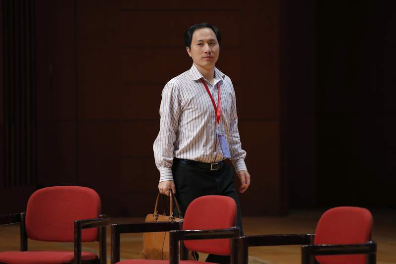 """FILE - In this Wednesday, Nov. 28, 2018 file photo, genetic researcher He Jiankui arrives for the Human Genome Editing Conference in Hong Kong. A new report from an international commission of scientists sets criteria for when altering genes in human embryos might be considered, two years after He shocked the world by claiming to have made the first """"CRISPR babies."""" (AP Photo/Kin Cheung)"""
