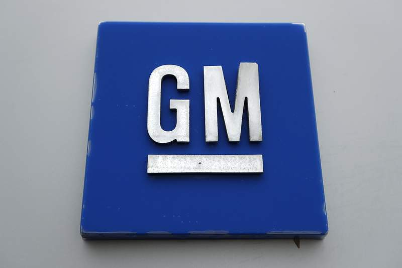 FILE - This Jan. 27, 2020, file photo shows a General Motors logo at the General Motors Detroit-Hamtramck Assembly plant in Hamtramck, Mich. Shares in electric- and hydrogen-powered truck startup Nikola plunged on Monday Sept. 21, 2020, after the company's founder Trevor Milton resigned amid allegations of fraud - just two weeks after signing a $2 billion partnership with General Motors. (AP Photo/Paul Sancya, File)