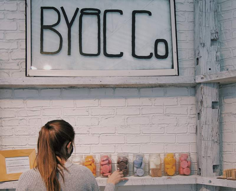 Shop owner Emma Hess sells natural products at BYOC Co.