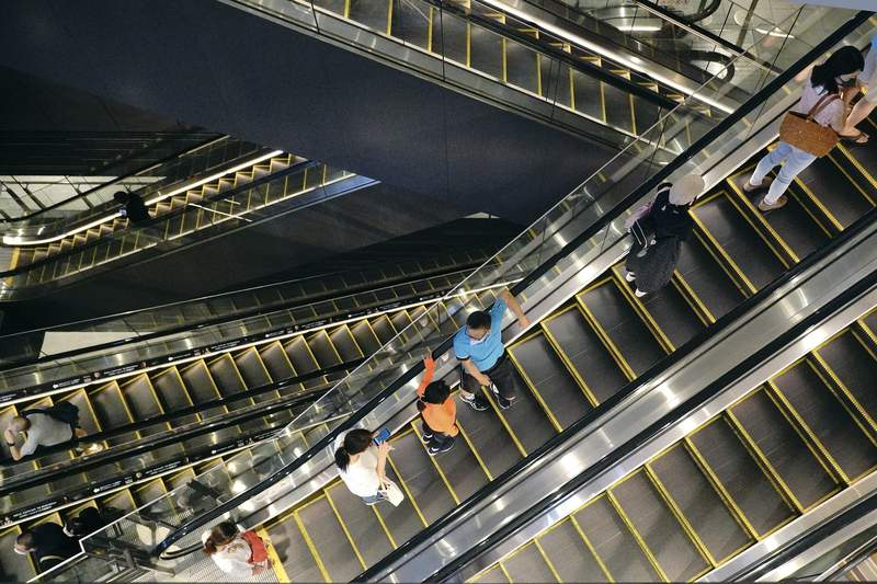 People take elevators at a shopping building in Tokyo on Aug. 24, 2020. Japans economy shrank at a record, even worse rate in the April-June quarter than initially estimated. The Cabinet Office said Tuesday, Sept. 8, 2020, Japans seasonally adjusted real gross domestic product contracted at an annualized rate of 28.1%, worse than the 27.8% figure given last month. (AP Photo/Eugene Hoshiko)