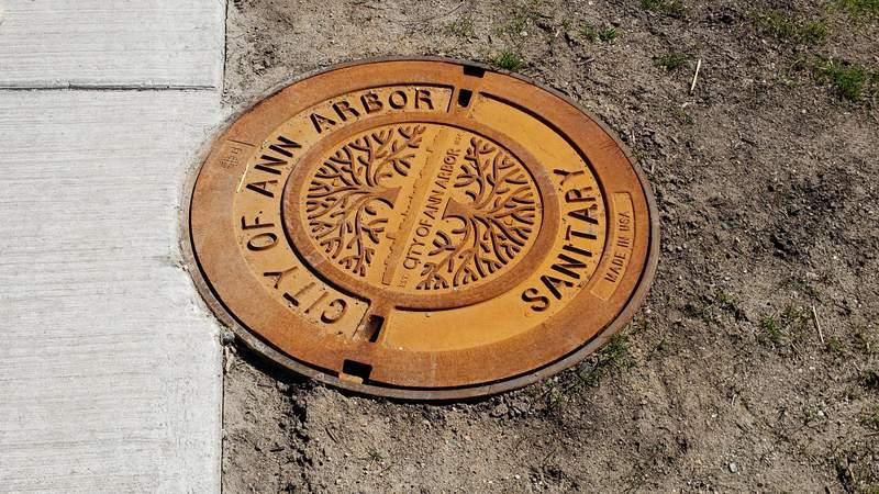 A manhole cover in downtown Ann Arbor.