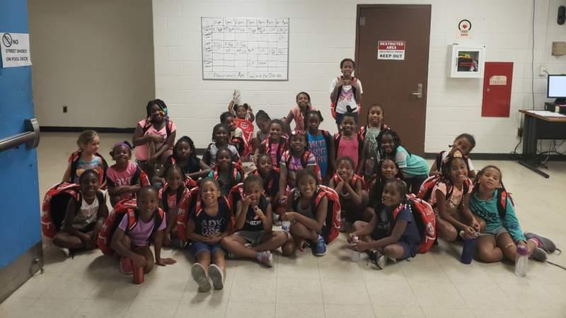 NFL player Joe Barksdale hosted a back-to-school giveaway for Detroit children on July 22, 2018. (WDIV)