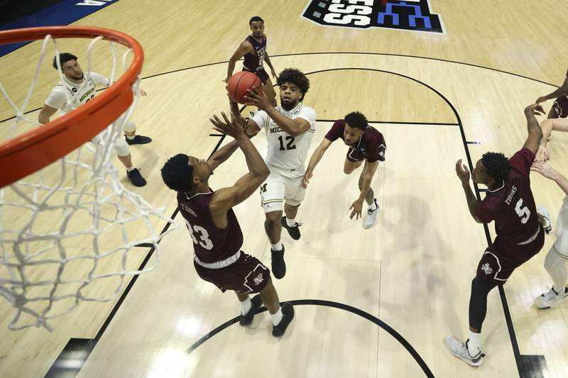 Mike Smith #12 of the Michigan Wolverines shoots against Quinton Brigham #33 of the Texas Southern Tigers during the first half in the first round game of the 2021 NCAA Men's Basketball Tournament at Mackey Arena on March 20, 2021 in West Lafayette, Indiana.