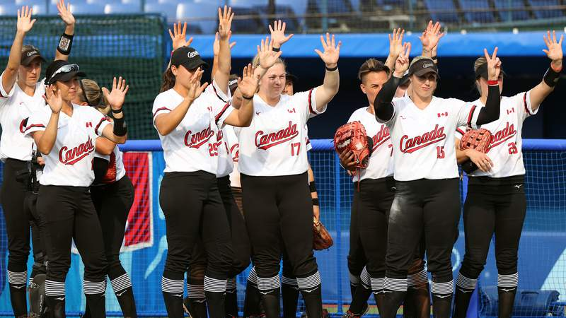 Team Canada wave to Team Italy after their game during softball opening round on day three of the Tokyo 2020 Olympic Games at Yokohama Baseball Stadium on July 26, 2021 in Yokohama, Kanagawa, Japan. Team Canada defeated Team Italy 8-1 in six innings.