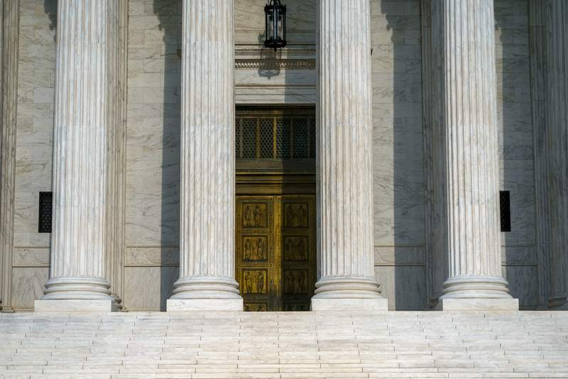 This Friday, Sept. 3, 2021, photo shows the Supreme Court in Washington. The Supreme Court's decision this past week not to interfere with the state's strict abortion law, provoked outrage from liberals and cheers from many conservatives. President Joe Biden assailed it. But the decision also astonished many that Texas could essentially outmaneuver Supreme Court precedent on women's constitutional right to abortion. (AP Photo/J. Scott Applewhite)