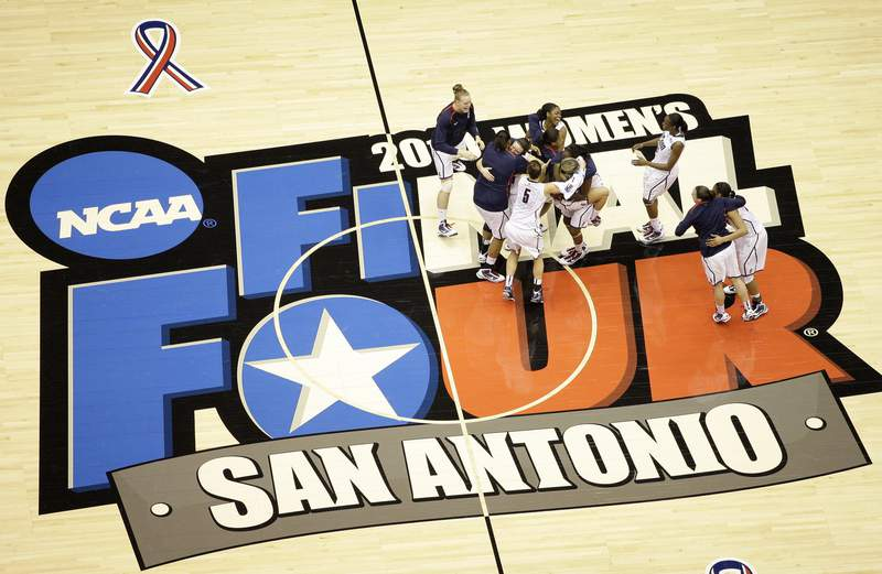 FILE - Connecticut players celebrate following the women's NCAA Final Four college basketball championship game against Stanford in San Antonio, in this Tuesday, April 6, 2010, file photo. Connecticut won 53-47. The San Antonio region will host the entire NCAA women's basketball tournament. The move Friday, Feb. 5, 2021, was made to help mitigate the risks of COVID-19 and matches that of the mens tournament, which the NCAA said last month will be played in the Indianapolis area.(AP Photo/Eric Gay, File)