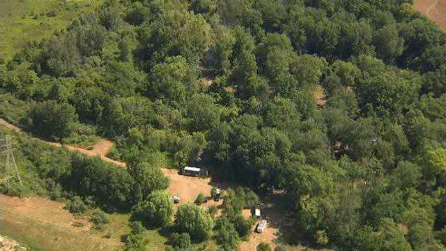 Police dig at a homicide search site in Macomb Township on Aug. 22, 2019. (WDIV)
