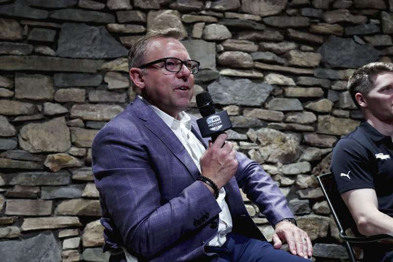 This photo provided by IndyCar shows Leigh Diffey at an IndyCar Series race in Monterey, Calif., in a Sept. 18, 2019, photo. Leigh Diffey has been stereotyped, if you will, as the speed guy at NBC Sports. He's the lead announcer for this weekend's Indianapolis 500 and most of his network involves sports that go fast. His next assignment has Diffey covering the fastest athletes in the world. The 50-year-old Australian has been named play-by-play announcer of NBC Olympics track & field coverage for the upcoming Tokyo Olympics. (Joe Skibinski/IndyCar via AP)