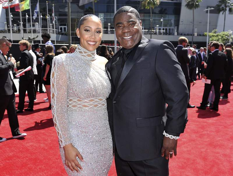 "FILE - Megan Wollover, left, and Tracy Morgan arrive at the ESPY Awards on July 10, 2019, in Los Angeles. Morgan and his wife of five years will part ways. The actor-comedian's representative said in an emailed statement Wednesday that Morgan and Wollover have filed for divorce. Morgan and Wollover married after the former ""Saturday Night Live"" cast member recovered from a 2014 highway crash in which a Wal-Mart truck slammed into the back of a limo Morgan was riding in. (Photo by Richard Shotwell/Invision/AP, File)"