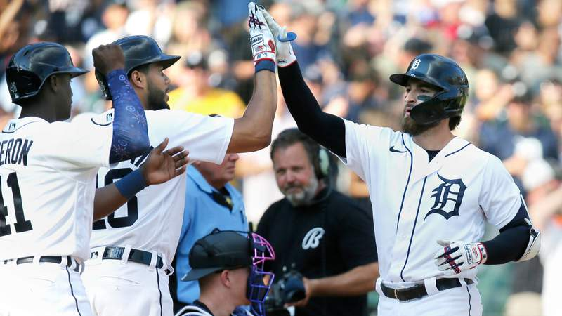 Eric Haase #13 of the Detroit Tigers celebrates his three-run home run against the Chicago White Sox with Daz Cameron #41 and Jeimer Candelario #46 during the seventh inning at Comerica Park on July 3, 2021, in Detroit, Michigan.