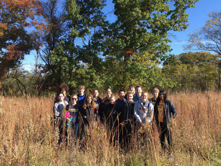 A fall eco-workday group poses for a photo in October 2019.