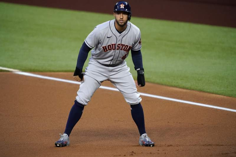 FILE - In this Sept. 25, 2020, file photo, Houston Astros' George Springer takes a lead off first during the first inning of the team's baseball game against the Texas Rangers in Arlington, Texas. Springer became the most prominent among baseballs free agents to reach an agreement, a $150 million, six-year contract with the Toronto Blue Jays, a person familiar with the negotiations told The Associated Press. The person spoke on condition of anonymity Tuesday night, Jan. 19, 20201, because the deal was subject to a successful physical. (AP Photo/Tony Gutierrez, File)