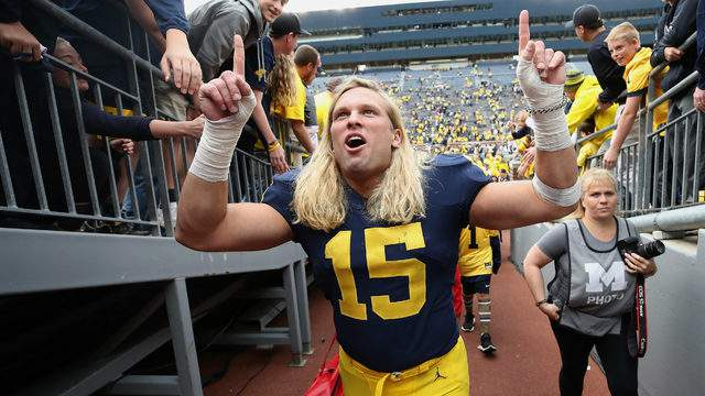 Chase Winovich leaves the field after a 56-10 win over Nebraska on Sept. 22, 2018, at Michigan Stadium in Ann Arbor. (Gregory Shamus/Getty Images)