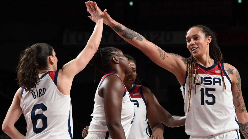 USA's Brittney Griner (R) and Sue Bird (L) celebrate a point in the women's semi-final basketball match between USA and Serbia during the Tokyo 2020 Olympic Games at the Saitama Super Arena in Saitama on August 6, 2021.