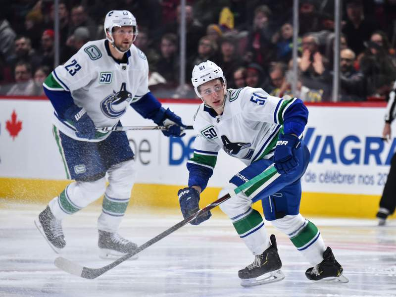 MONTREAL, QC - FEBRUARY 25:  Troy Stecher #51 of the Vancouver Canucks skates against the Montreal Canadiens during the third period at the Bell Centre on February 25, 2020 in Montreal, Canada.  The Vancouver Canucks defeated the Montreal Canadiens 4-3 in overtime.  (Photo by Minas Panagiotakis/Getty Images)