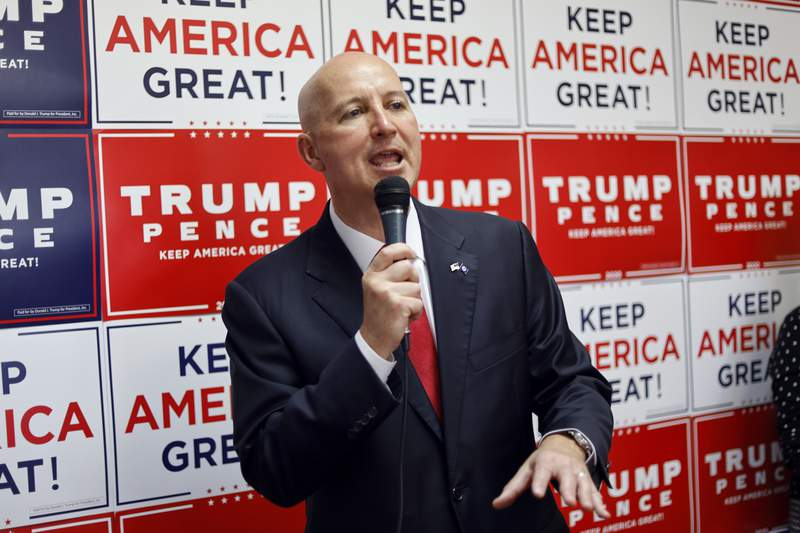 FILE - In this Aug. 20, 2020 file photo, Nebraska Gov. Pete Ricketts addresses Republican supporters during the opening of the Nebraska Trump Victory Office in Omaha, Neb. Ricketts will end nearly all of his state's social-distancing restrictions on Monday, Sept. 14, 2020, even as the number of new coronavirus cases has trended upward over the last few months. (AP Photo/Nati Harnik File)