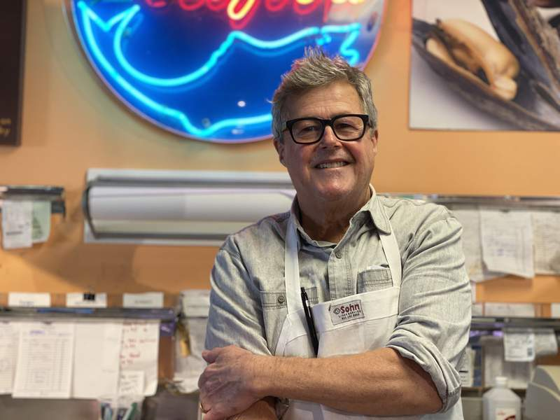 Owner Mike Monahan behind the counter at Monahan's Seafood Market on Feb. 3, 2020.