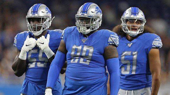 DETROIT, MI - AUGUST 8: Eric Lee #55, John Atkins #99 and Jahlani Tavai #51 of the Detroit Lions line up during the preseason game against the New England Patriots at Ford Field on August 8, 2019 in Detroit, Michigan. New England defeated Detroit 31-3. (Photo by Leon Halip/Getty Images)
