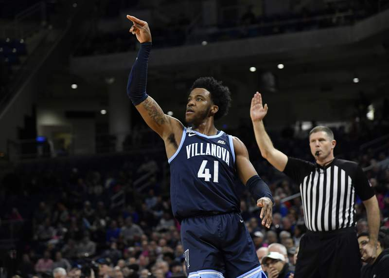 CHICAGO, ILLINOIS - FEBRUARY 19: Saddiq Bey #41 of the Villanova Wildcats shoots a three point basket against the DePaul Blue Demons at Wintrust Arena on February 19, 2020 in Chicago, Illinois. (Photo by Quinn Harris/Getty Images)