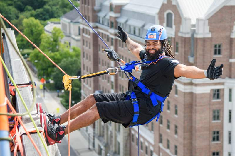 """Participants go """"Over the Edge"""" of the Graduate Ann Arbor hotel in a fundraiser for Friends in Deed on September 4, 2020."""