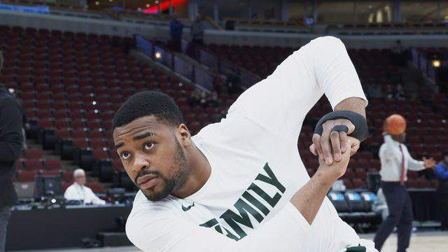 Nick Ward with a brace on his left hand (Michigan State University)