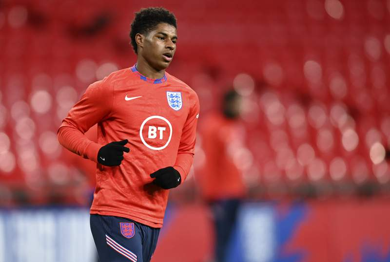 FILE - In this Wednesday, Oct. 14, 2020 file photo, England's Marcus Rashford warms up ahead of their UEFA Nations League soccer match against Denmark at Wembley Stadium in London, England. Rashford was hailed a hero in June when he successfully lobbied British Prime Minister Boris Johnson's government to extend free school meals through the summer. But one of Britain's feel-good stories of the coronavirus pandemic has taken a dark turn. (Daniel Leal-Olivas/Pool via AP, file)