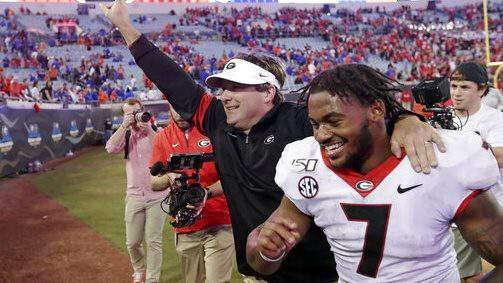 Georgia head coach Kirby Smart and running back D'Andre Swift (7) run off the field celebrating after defeating Florida in an NCAA college football game, Saturday, Nov. 2, 2019, in Jacksonville, Fla. (AP Photo/John Raoux)