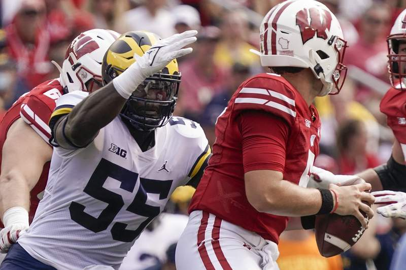 Michigan's David Ojabo sacks Wisconsin's Graham Mertz during the first half of an NCAA college football game Saturday, Oct. 2, 2021, in Madison, Wis.