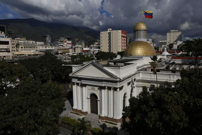 FILE - In this Jan. 6, 2020 file photo, the National Assembly stands in Caracas, Venezuela. Opposition lawmakers in Venezuela quietly agreed on the second week of April 2020, to pay themselves a $5,000 a month when they approved special $100 bonuses for doctors and nurses battling the coronavirus, a large payout for a nation where most workers are scraping by on couple of dollars a month,  according to people involved in the process. (AP Photo/Andrea Hernandez Briceo, File)
