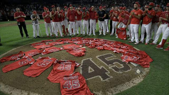 Los Angeles Angels of Anaheim players lay their jerseys on the pitchers mound after they won a combined no-hitter agasint the Seattle Mariners at Angel Stadium of Anaheim on July 12, 2019 in Anaheim, California. (Photo by John McCoy/Getty Images)