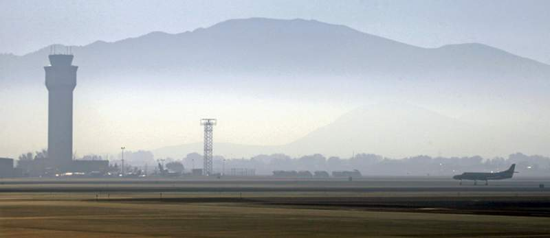 File - In this Sept. 24, 2014 file photo, smoke hangs over Reno-Tahoe International Airport as a plane takes off in Reno, Nev. A shortage of jet fuel, coupled with supply chain issues and an urgent demand from firefighting aircraft, continues to cause problems at airports around the West. In Nevada, state and federal lawmakers said they are investigating a possible shortage of jet fuel that could delay cargo delivery and passenger travel at Reno-Tahoe International Airport in the coming days. (AP Photo/Martha Irvine, File)
