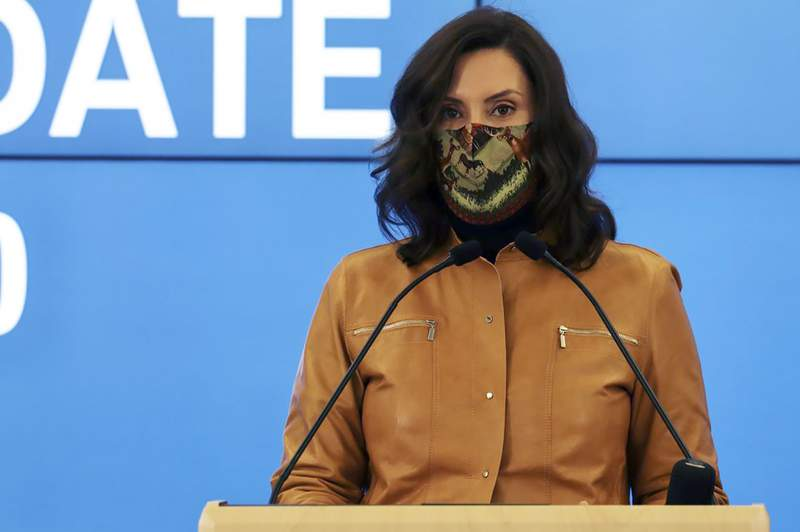 In this photo provided by the Michigan Office of the Governor, Gov. Gretchen Whitmer addresses the state during a speech in Lansing, Mich., Sunday, Nov. 15, 2020. Whitmer said Monday, Nov. 16 she has the authority to issue a second stay-at-home order to curb the spiking coronavirus if necessary, pointing to an epidemic-powers law that her administration has used since a setback at the state Supreme Court.  Starting Wednesday, Nov. 18 high schools and colleges must halt in-person classes, restaurants must stop indoor dining and entertainment businesses must close. Gathering sizes also will be tightened. (Michigan Office of the Governor via AP)