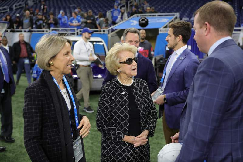 Detroit Lions vice chair Sheila Ford Hamp and Detroit Lions owner and chairman Martha Firestone Ford talks to Detroit Lions executive vice president & general manager Bob Quinn before an NFL football game against the Chicago Bears on Thursday, Nov. 22, 2018 in Detroit. (Detroit Lions via AP).