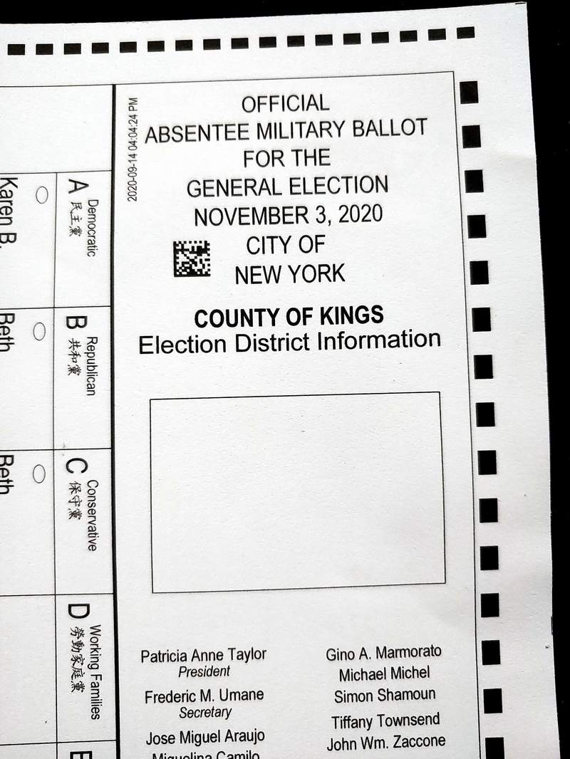 """This Tuesday, Sept. 29, 2020 photo, shows a section of an absentee ballot marked """"Absentee Military Ballot,"""" that was mailed to a registered voter in in the Brooklyn borough of New York. Some New York City voters have received absentee ballots with the wrong names and addresses on the return envelopes. The faulty ballots were sent to unknown number of voters in Brooklyn that could result in some ballots being voided if voters signed their own name on return envelopes bearing different names. (AP Photo)"""