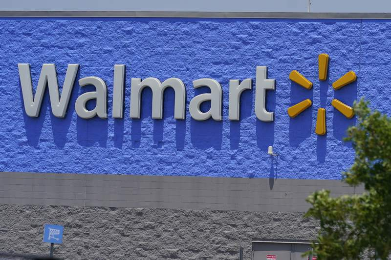 This June 24, 2021 photo shows a Walmart store in Oklahoma City.  Walmart is raising its annual outlook for a key sales metric after reporting fiscal second-quarter results that beat analysts projections. The results, announced Tuesday, Aug. 17, underscore how Bentonville, Arkansas-based continues to retain its customers and keep sales humming as shoppers start to go back to almost normalcy.  (AP Photo/Sue Ogrocki)
