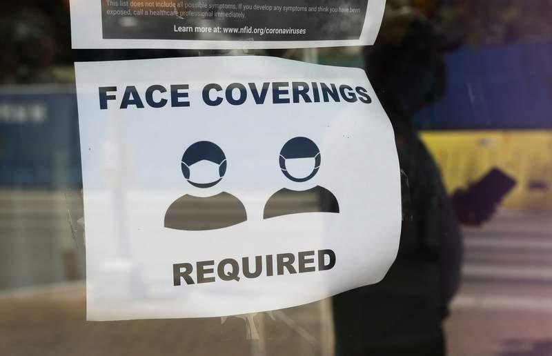 A sign requiring masks. (AP Photo/Eric Gay, File)
