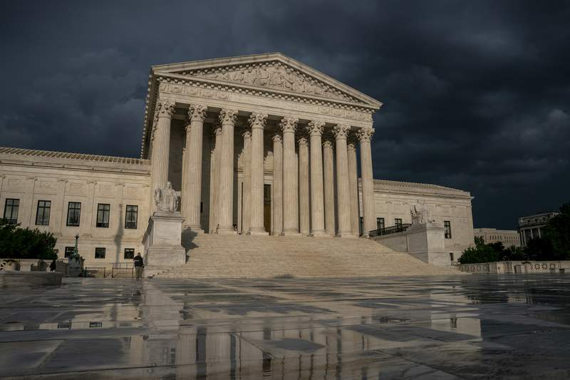 FILE - In this June 20, 2019 file photo, the Supreme Court is seen under stormy skies in Washington. (AP Photo/J. Scott Applewhite)