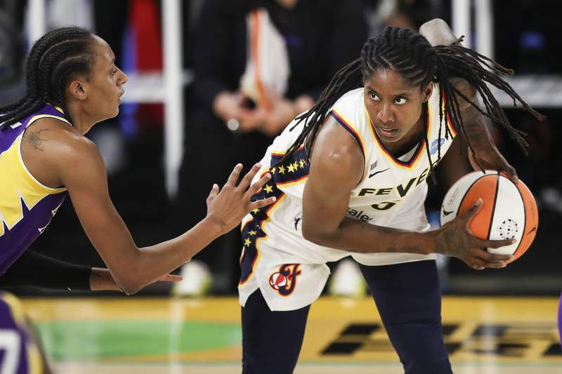 LOS ANGELES, CALIFORNIA - JUNE 03: Jessica Breland #51 of the Indiana Fever handles the ball against Brittney Sykes #15 of the Los Angeles Sparks at Los Angeles Convention Center on June 03, 2021 in Los Angeles, California. NOTE TO USER: User expressly acknowledges and agrees that, by downloading and or using this photograph, User is consenting to the terms and conditions of the Getty Images License Agreement. (Photo by Meg Oliphant/Getty Images)