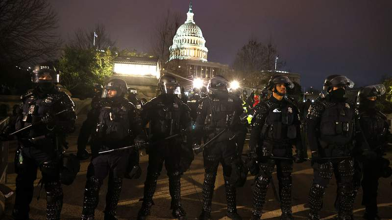 Police officers in riot gear line up as protesters gather on the U.S. Capitol Building on January 06, 2021 in Washington, DC. Pro-Trump protesters entered the U.S. Capitol building after mass demonstrations in the nation's capital during a joint session Congress to ratify President-elect Joe Biden's 306-232 Electoral College win over President Donald Trump.