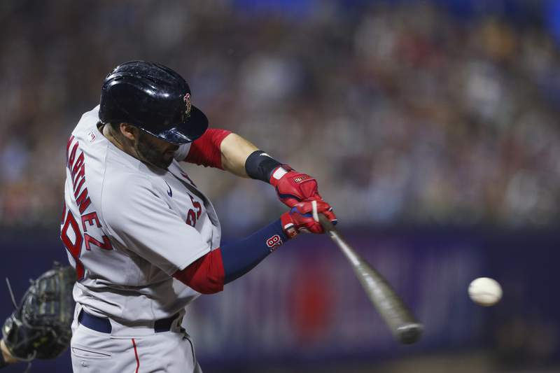 Boston Red Sox's J.D. Martinez hits a home run during the eighth inning of the team's baseball game against the Boston Red Sox on Wednesday, July 21, 2021, in Buffalo, N.Y. (AP Photo/Joshua Bessex)