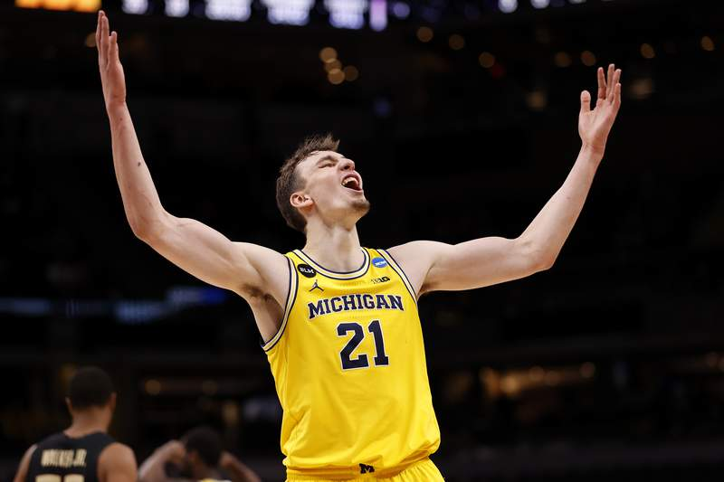 Franz Wagner #21 of the Michigan Wolverines celebrates in the final moments of the second half of their Sweet Sixteen round game against the Florida State Seminoles in the 2021 NCAA Men's Basketball Tournament at Bankers Life Fieldhouse on March 28, 2021 in Indianapolis, Indiana.