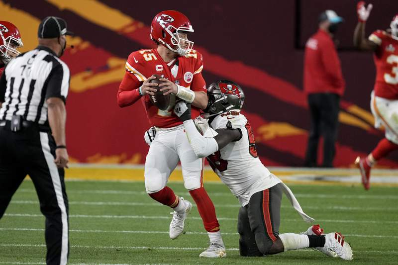 Kansas City Chiefs quarterback Patrick Mahomes (15) looks to throw a pass while in the grasp of Tampa Bay Buccaneers outside linebacker Shaquil Barrett, right, during the second half of the NFL Super Bowl 55 football game, Sunday, Feb. 7, 2021, in Tampa, Fla. (AP Photo/Chris O'Meara)