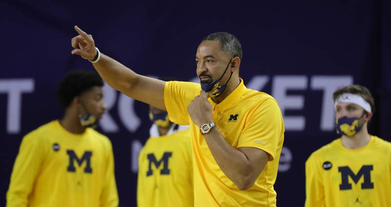 Head coach Juwan Howard of the Michigan Wolverines calls a play from the sideline during the second half of the game against the Wisconsin Badgers  at Crisler Arena on January 12, 2021 in Ann Arbor, Michigan. Michigan defeated Wisconsin 77-54.