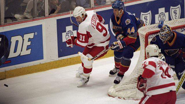May 17, 1998: Sergei Fedorov and Chris Pronger battle for the puck in the Western Conference Semifinals (Elsa Hasch /A)