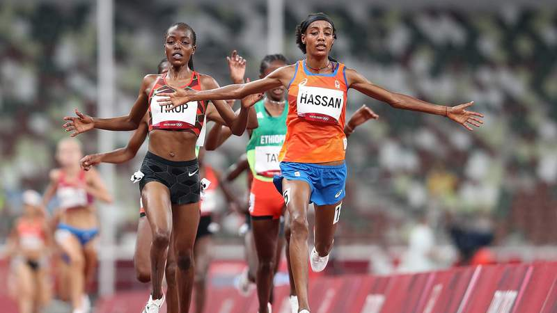 TOKYO, JAPAN - JULY 30: Sifan Hassan of Team Netherlands crosses the finish line first ahead of Agnes Jebet Tirop of Team Kenya in Heat 1 of the Women's 5000m Round 1on day seven of the Tokyo 2020 Olympic Games at Olympic Stadium on July 30, 2021 in Tokyo, Japan. (Photo by Christian Petersen/Getty Images)