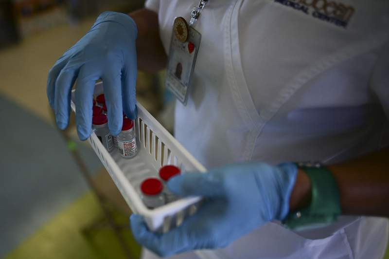 A nurse carries vials of the Moderna COVID-19 vaccine. (AP Photo/Carlos Giusti)