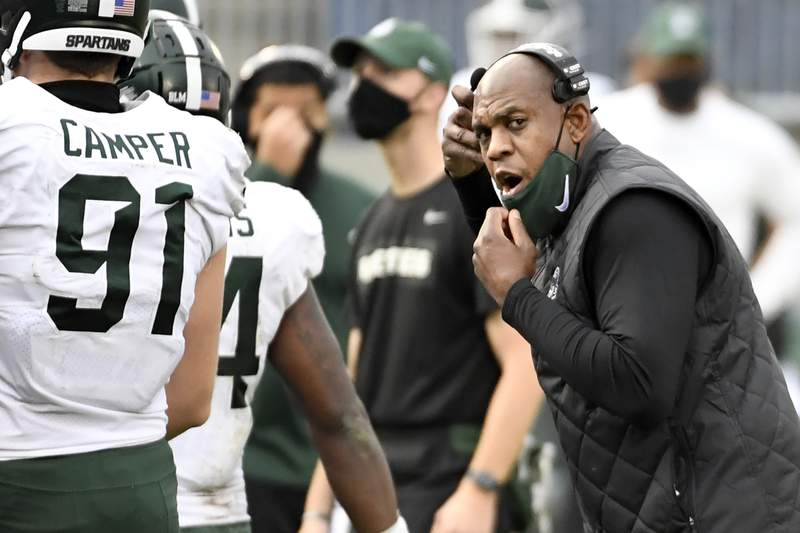 Michigan State head coach Mel Tucker talks to defensive end Jack Camper (91) during an NCAA college football game against Penn State in State College, Pa., on Saturday, Dec. 12, 2020. Penn State defeated Michigan State 39-24.
