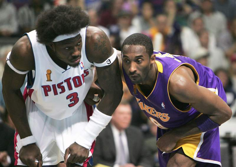 AUBURN HILLS, MI - JUNE 13:  Ben Wallace #3 of the Detroit Pistons and Kobe Bryant #8 of the Los Angeles Lakers battle for position in the first half of game four of the 2004 NBA Finals on June 13, 2004 at The Palace of Auburn Hills in Auburn Hills, Michigan.  NOTE TO USER: User expressly acknowledges and agrees that, by downloading and or using this photograph, User is consenting to the terms and conditions of the Getty Images License Agreement.  (Photo by Jed Jacobsohn/Getty Images)