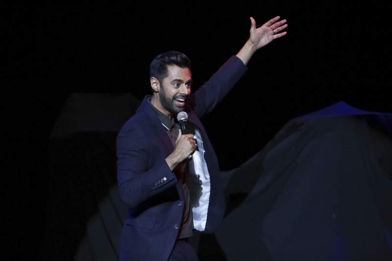 """FILE - In this Nov. 7, 2017 file photo, comedian Hasan Minhaj performs on stage during the 11th Annual Stand Up for Heroes benefit, presented by the New York Comedy Festival and The Bob Woodruff Foundation, at the Theater at Madison Square Garden, in New York. Minhaj, of Netflixs Patriot Act with Hasan Minhaj,"""" and Kenan Thompson of Saturday Night Live will headline this years White House Correspondents Dinner, which takes place April 25, 2020.  (Photo by Brent N. Clarke/Invision/AP)"""