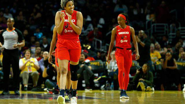 LOS ANGELES, CALIFORNIA - JUNE 18: Forward Tianna Hawkins #21 of the Washington Mystics claps after she was fouled during a game against the Los Angeles Sparks at Staples Center on June 18, 2019 in Los Angeles, California. (Photo by Katharine Lotze/Getty Images)